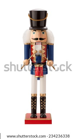 Antique Nutcracker Drummer with a red drum. He has white hair and beard. He sports a black hat, with a blue coat and black boots. The point of view is straight on, and is isolated on white background. - stock photo