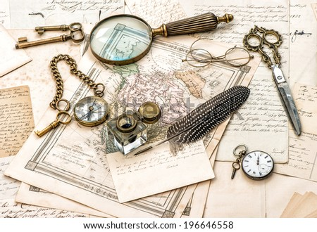 antique office accessories, old handwritten mails and vintage ink pen - stock photo