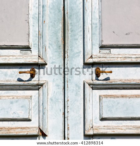 antique old door and ancien wood closed house hinge  - stock photo