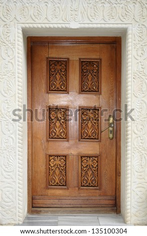 Antique ornate wooden door - stock photo