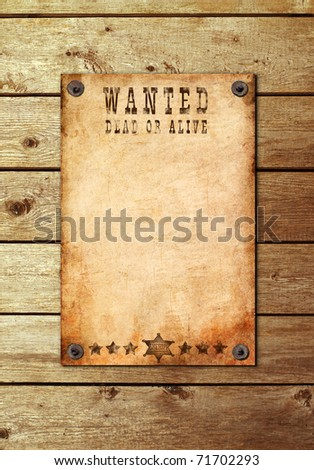 antique page - wanted dead or alive. Vintage wanted poster on a wooden wall