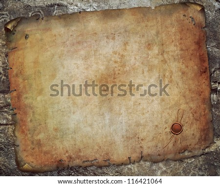 Antique paper scroll on the  wall - stock photo