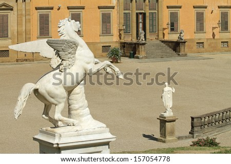 Antique Pegasus sculpture in Boboli Garden  and Pitti Palace at the background, Florence, Italy - stock photo
