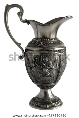 Antique pewter pitcher with a beautiful relief and cover isolated on white background