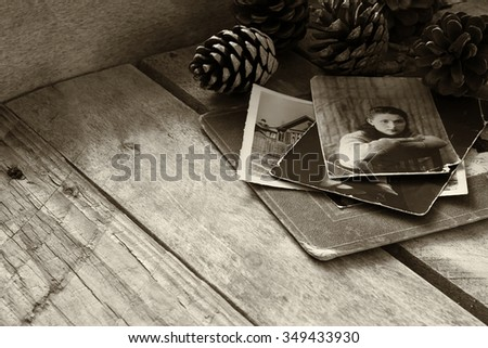 antique photos and old book on wooden table. black and white style photo. selective focus - stock photo