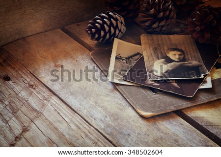 antique photos on wooden table. filtered image. selective focus - stock photo