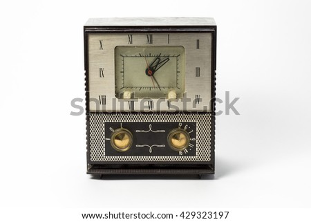 Antique plastic 1950's clock radio brown on white background