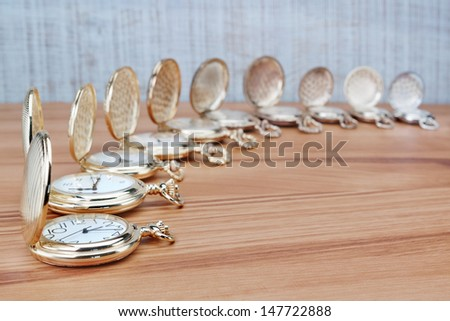 Antique pocket watch in a row with the lid open. Close-up. - stock photo