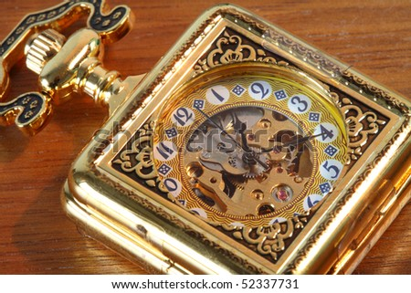 Antique pocket watch on the table. - stock photo
