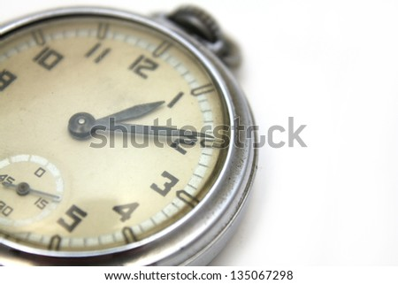 antique pocket watch over white background
