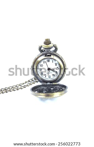 Antique pocket watch with open lid. Isolated on white background.