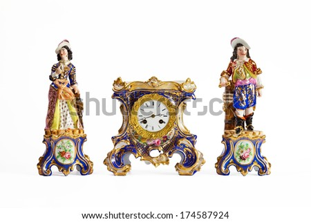 Antique porcelain clock with statues - stock photo