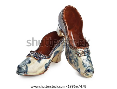 Antique porcelain souvenir-ladies shoes - stock photo