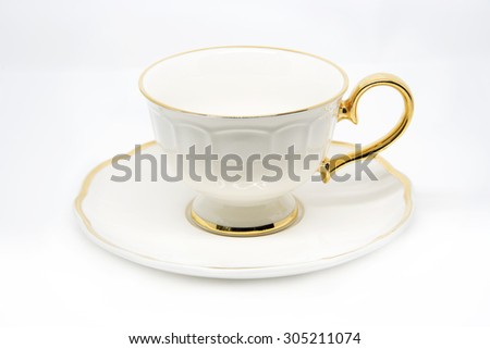 Antique porcelain tea cup & saucers on white background. - stock photo