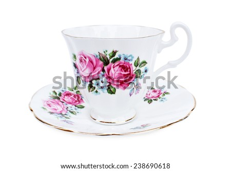 Antique porcelain tea cup & saucers with floral painting on white background - stock photo