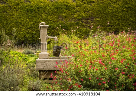 Antique pump in garden in, Giverny, France - stock photo