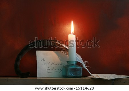 Antique quill and letters set on a mantle piece with a candle against a 'grunge' style background. Mood evocative shot. Copy space available.
