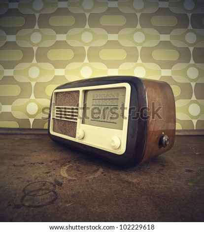 antique radio on vintage background - stock photo