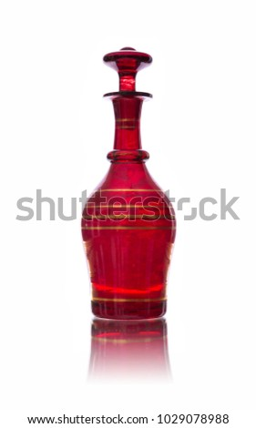 Antique red glass carafe isolated on white backround