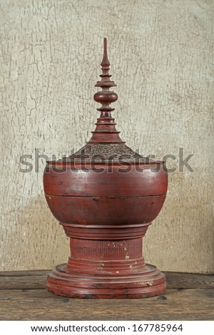 Antique red lacquer wares in wooden crack background (Still life)