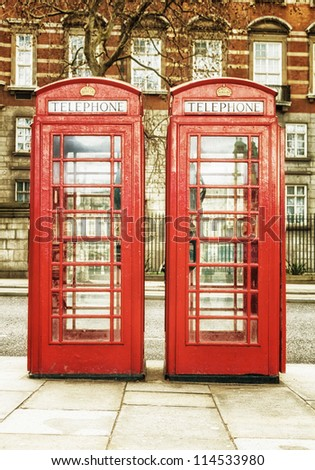 Antique red phone cabins, a worldwide known symbol of  London - stock photo