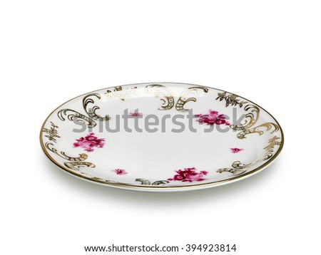 Antique saucer or dish on white background including clipping path. - stock photo