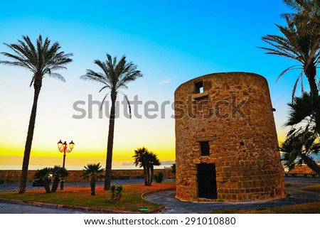 antique sighting tower by the sea in Alghero, Sardinia - stock photo