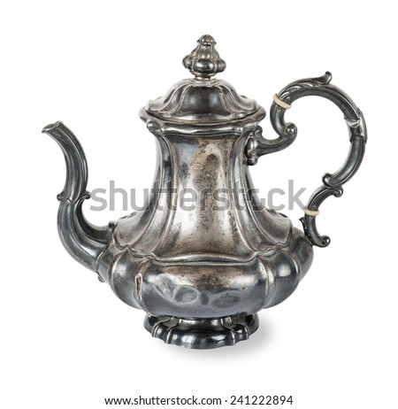 Antique silver coffee pot on a white background