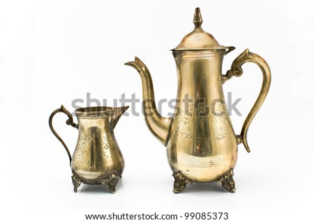 Antique silver teapot and jug isolated on white