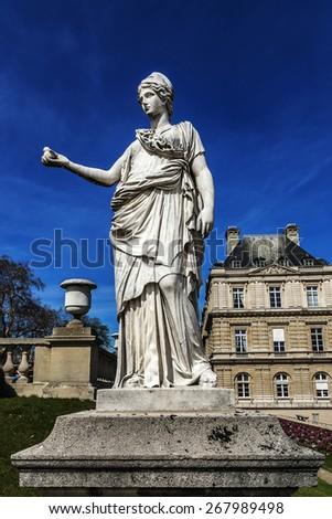 Antique Statue in Luxembourg garden (Jardin du Luxembourg). Jardin du Luxembourg is second largest Public Park in Paris, France. Park is garden of French Senate.  - stock photo