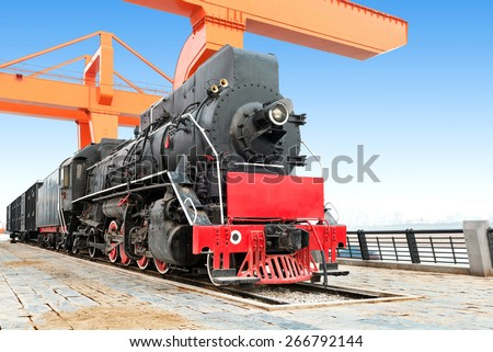 Antique steam train waiting for departure - stock photo