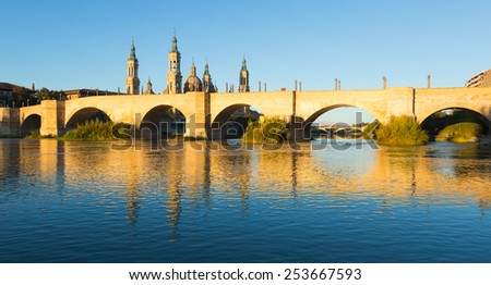 antique stone bridge in sunny morning. Zaragoza,  Spain