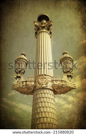 antique street lamp on the famous square Place de la Concorde in Paris, France - stock photo