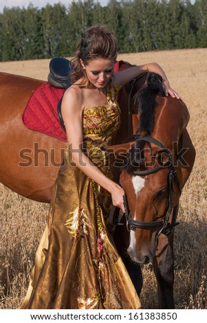 Antique style woman with horse - stock photo
