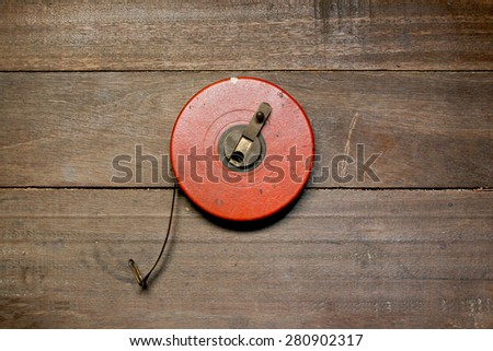 Antique tape measure on wooden table