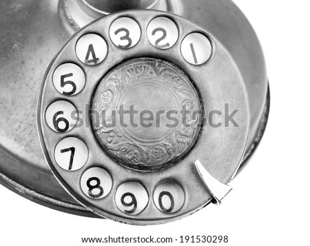 Antique Telephone - Antique candlestick telephone dialer in black and white. - stock photo