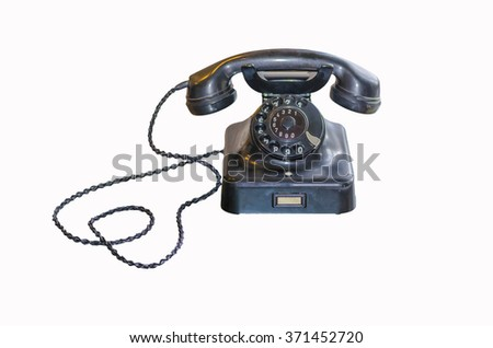Antique Telephone Black Bakelite with dial on white background  - stock photo