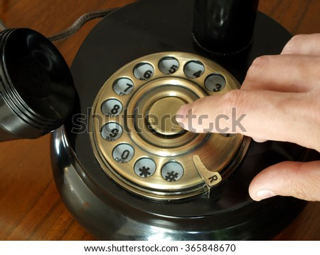 antique telephone disk dealer close up