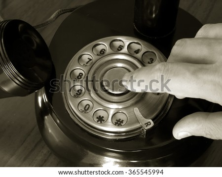 antique telephone disk dealer close up monochrome image - stock photo
