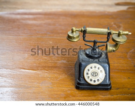 Antique telephone on wood floor