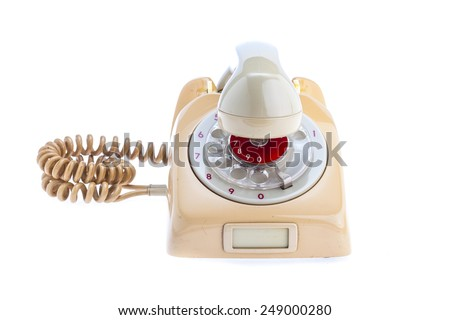 Antique Telephone Placed on a isolated white background. The headset is removed from the set. Placed in a cross on top of the machine. - stock photo