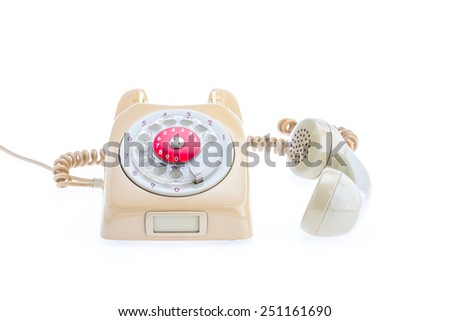 Antique Telephone Placed on a isolated white background. The headset is removed from the set. Placed next to the side. - stock photo