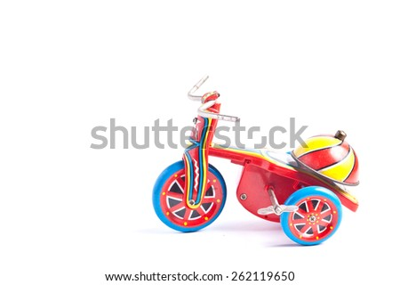 antique tin toy  tricycle on white background - stock photo