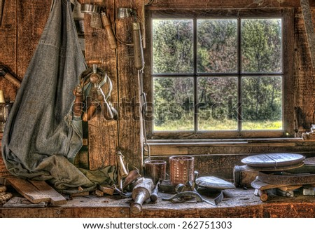 Antique Tools on a Workbench in Front of a Window