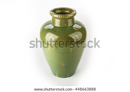 Antique traditional green vase on a white background