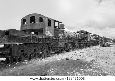Antique train cemetery - Uyuni, Bolivia (black and white) - stock photo