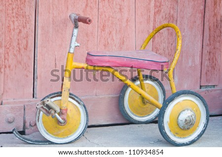 Antique tricycle - stock photo