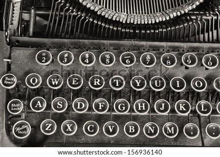 Antique Typewriter IV - An Antique Typewriter Showing Traditional QWERTY Keys IV - stock photo