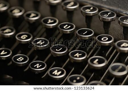 Antique typewriter keys. Detail shot of keys on an old typewriter. Shallow DOF. - stock photo