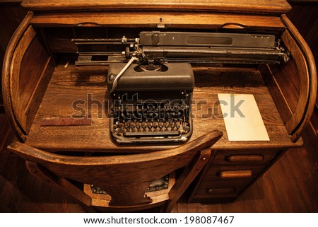 Antique typewriter on an old wooden desk - Antique Desk Stock Images, Royalty-Free Images & Vectors